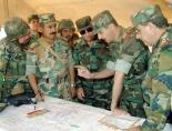 Syrian President Bashar Al-Assad with commanders of the Syrian army [Source:  http://www.presidentassad.net]